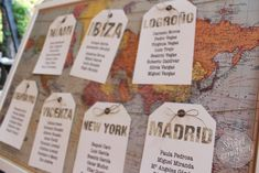 Seating plan cities on a vintage map? Globes as centerpeices? Could be very funky.