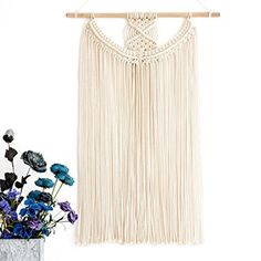 Forgo art and add some texture to walls with this macrame wall hanging. It feels light and airy but still adds interest.