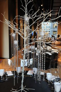 Centerpieces included branches hung with crystals and candles. Photo: George Pimentel