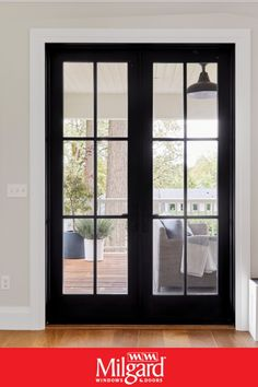 Black French patio doors add an dark elegance to this farmhouse patio. Featuring Ultra™ Series Patio Doors. #patiodoorideas #frenchpatiodoors #patiodoormakeover
