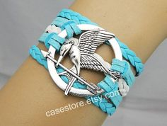 Mockingjay pin braceletlighting green leather by charmcover, $7.99