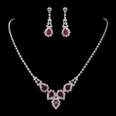"""Silver plated foldover clasp necklace with round AB rhinestones. Comes with a matching pair of dangle earrings. Size: Necklace - 16"""" or 18"""" Long. Earrings - 1 1/2"""" Long. $79.99 Kim's Bridal,  Keywords:   #michiganbridalshop #weddingaccessories #partyfavors #kimsbridal Follow Us: http://www.kimsgiftbaskets.com/ ... https://www.facebook.com/KimsGifts"""
