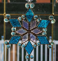 Stained glass baby blue snowflake by ManemannArt on Etsy, $30.00