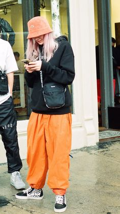 25f267b748320 Vintage orange pants styled with Drux maps hoodie and Supreme side bag  paired with Supreme Lacoste