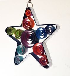 Quilled Star Scrolls and a Coiled Center Rainbow colors Paper Ornaments, Handmade Ornaments, Holiday Ornaments, Holiday Gifts, First Anniversary Paper, Quilled Paper Art, Star Ornament, Thank You Gifts, Nursery Art