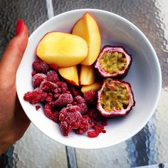 Looks like frozen raspberries, mango, and passion fruit. Whatever it is, it's beautiful and I bet delicious
