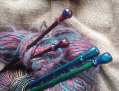 Hand turned knitting needles of color wood, dyed wood colors, peacock and red/purple. the peacock colored set is size 10 1/2 and is 11 long, and the