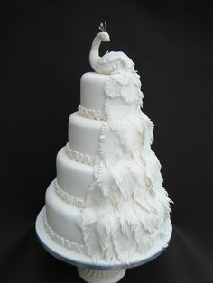 All White Peacock Wedding Cake (why not have a peacock cake topper...  Nothing like a bird sitting on your cake)