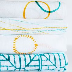 Create these cool dish towels with fabric paint and common kitchen items.