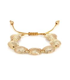 TOHUM Design is known for its free-spirited sea-inspired designs and this Concha Beach bracelet is a way to bring a sun-drenched vacation to your everyday. It's been crafted from gold in the shape of curved shells and .