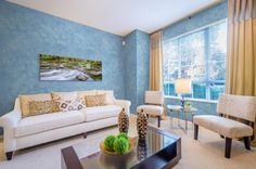 http://www.justsoakit.com/wp-content/uploads/2014/12/beautiful-blue-wall-design-idea-in-cool-living-room-with-beige-curtain-glass-window-as-well-lamp-desk-front-window-and-glass-table-including-classic-sofa-945x625.jpg