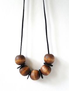 Stained Wood Bead Necklace Tutorial by Fabric Paper Glue 01.png by fabricpaperglue, via Flickr