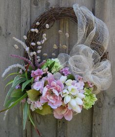 Summer Wreath , Pretty pink geraniums, bright spring green and pale pink ruffle edge peonies along with soft white mini tulips mingle with berries, wildflowers and pussy willows.Floral Wreath Easter Wreath Summer Garden by NewEnglandWreathWith Easter Wreath Crafts, Diy Wreath, Grapevine Wreath, Wreath Ideas, Tulle Wreath, Easter Wreaths, Holiday Wreaths, Couronne Diy, Corona Floral