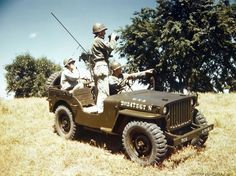 A GI in the back seat of a jeep sends a telephone message during Signal Corps training in the field ~