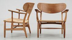 A pair of Hans J Wegner easy chairs by Carl Hansen & Son, Denmark. Marked underneath.