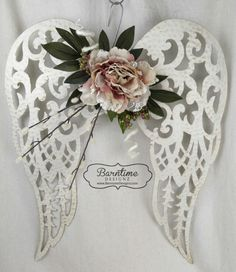 Angel wings, creamy white with shabby chic farmhouse touch. We can do a custom design for you, just contact us.  These wings are perfect for a birthday, wedding, shower, your own home or as a special sympathy arrangement.  Just let us know. angel wings, angel wings with flowers, angel wing arrangement, wedding arrangement, sympathy arrangement