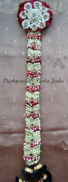 Poola jada with real jasmine flowers,red rose petals, and applique. Poola jada with real jasmine flo Bridal Hairstyle Indian Wedding, South Indian Bride Hairstyle, Bridal Hair Buns, Bridal Hairdo, Indian Bridal Hairstyles, Bridal Hair Flowers, Cute Bridal Shower Gifts, Bridal Shower Decorations, Flower Decorations