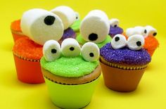 GREAT idea for cupcakes for a monster-themed party or Halloween. (Edible markers to make eyes on marshmallows.)