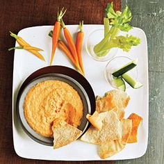 Roasted Red Pepper Hummus   Ingredients    * 1/3 cup tahini (sesame seed paste)       * 1/4 cup water      * 1/4 cup chopped bottled roasted red bell peppers, rinsed and drained      * 2 tablespoons fresh lemon juice       * 1/4 teaspoon salt      * 1 garlic clove, minced      * 1 (15 1/2-ounce) can chickpeas, rinsed and drained    Preparation     1. Place all ingredients in a food processor; process until smooth.