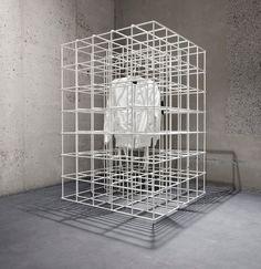 White metal display cages added to ETQ Store Amsterdam by Studio Jos van Dijk