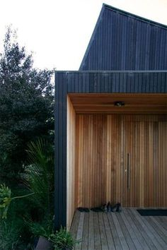 A Wellington, New Zealand home renovation by BC+A Architecture. Wood slat shoes at entry deep recess volume entry positive and negative space