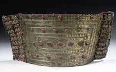 Turkmenistan   Tekke silver and gilt waistband; of curved form, set with raised carnelians and formed of a series of rectangular panels with openwork triangles and incised wave designs.  Backed on floral cloth and with side panels stitched with small metal wing motifs   19th century   1,320€ ~ sold (Apr 10)