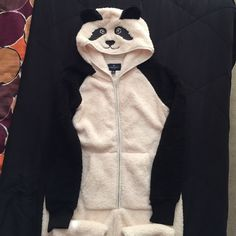 American Eagle Panda Onesie  Brand new panda onesie with tags. My boyfriend bought me this for Christmas, but it didn't fit right because I'm too tall :( Sold out on most websites because it's adorable ❤️ Sorry for the poor quality picture at the end. I got it from Google, and it was already blurry. Let me know if you have any questions :) American Eagle Outfitters Intimates & Sleepwear Pajamas