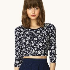 """Floral Navy Crop Top M Forever 21 floral print navy crop top. Size Medium. Pit to pit is 17.5"""" In great pre-loved condition. Forever 21 Tops Crop Tops"""