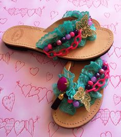 Handmade leather sandals decorated with turquoise lace, pink and purple beads, pink acrylic chain and gold butterfly.