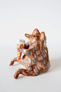 Karin Hagen: ceramic - beastie with ice cream cone, based on video of a woodchuck eating same