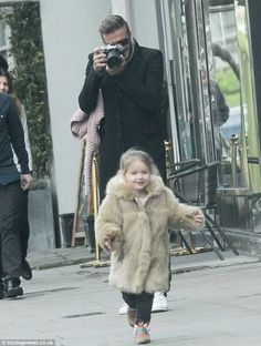 Doting dad: David Beckham snapped pictures of his daughter Harper as they enjoyed a daddy - daughter day out in London last week