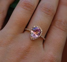I love the color: 2.2ct Peach pink champagne tear drop sapphire and rose gold diamond engagement ring. $2,450.00 CAD, via Etsy.
