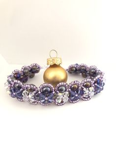 Hand sewn made to measure beaded bracelet, I then added a layer of Swarovski Crystals in purple velvet and CrystalAB, finished in sterling silver Purple Velvet, Crystal Bracelets, Hand Sewn, Swarovski Crystals, Handmade Jewelry, Sterling Silver, Beautiful, Hand Print Ornament, Craft Jewelry