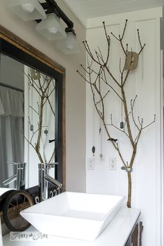 Tree branch jewelry holder in salvaged farmhouse bathroom makeover via… Rama Seca, Deco Cool, Diy Bathroom Decor, Bathroom Ideas, Bathroom Makeovers, Bathroom Pictures, Bathroom Shelves, Bath Decor, Bathroom Designs