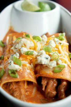 Buffalo Chicken Enchiladas ~ This is a really simple dish of chicken mixed with creamy ranch dressing, Greek yogurt, hot sauce and a little enchilada sauce.
