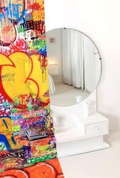 split-personality house! half pristine, half graffit bomb.