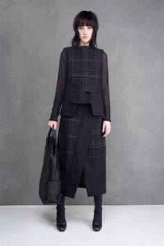 Sleeveless top with hemline made of asymmetric panels and a shorter upper layer with contrast weaving Malloni