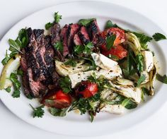 "Grilled Hanger Steak with Fennel Salad ""Hang(er) In There! The Best Inexpensive Steak for the Grill Hanger Steak is like that indie band that hasn't quite hit top-40 mainstream status yet, but is big enough that everybody and their mother's heard about it. Most have even given it a try. For a long, long time it wasn't even sold to the general public, reserved mostly for ground beef, or taken home by the butchers (earning it the nickname ""butcher's steak."" 
