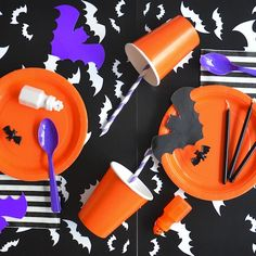 Plain paper goods & cutout bats are all you need for the perfect halloween party!