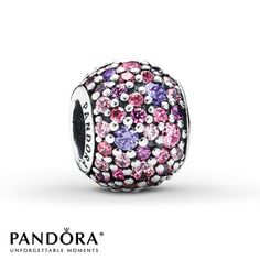 Pink and purple cubic zirconias form an array of colorful Pavé Lights in this sterling silver charm from the Pandora Spring 2014 collection. Style # 791261ACZMX.