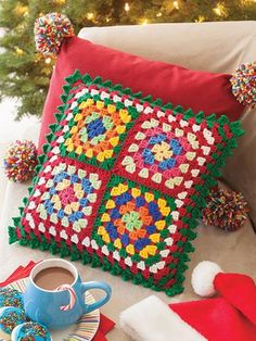 Decorate the tree and mantel with ornaments, a tree skirt, stocking, and garland while making the couch a cozy haven with the colorful blanket and pillow. There's even a mug cozy and trivet to brighten up the kitchen or Santa's visit. Also included are thoughtful gifts in a hat, scarf, cowl, and fingerless mitts that will warm hearts as well as heads, necks, and fingers.  View more here: http://www.maggiescrochet.com/products/a-granny-square-christmas