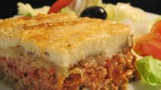 Here is a great recipe for moussaka, a Greek dish. It includes sliced eggplant baked in a ground beef sauce and then smothered in a thin white sauce.