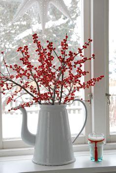 Red winter berries make a sweet Christmas arrangement.