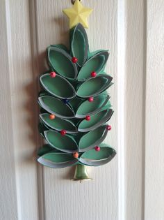Christmas tree door decoration made of toilette paper rolls. With beads and a bell as it's trunk.