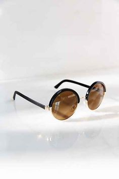 c0d73a7d33 Must-have round sunglasses with leather-wrapped framing complete with UV  protected tinted lenses.