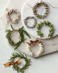 From top left, here are what we used to make this selection: mini carnations, wax myrtle berries, purple oregano, ferns, green oregano, strung white hyacinth, and sprigs of rosemary.
