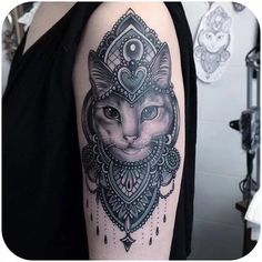 Feminine and ornate Black & Grey cat-too made by Flo Nuttall