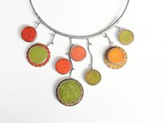 Pendant necklace of vintage Bakelite game pieces set in sterling silver by Sally Bass at John Rippel U. Leather Gifts For Her, Unusual Gifts For Her, Jewelry Gifts, Jewelry Necklaces, Flower Necklace, Belt Buckles, Sally, Pendant Necklace, Drop Earrings