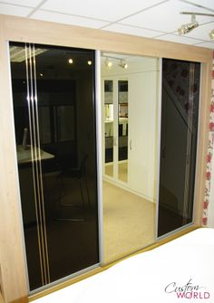 Dark Wood Surround Sliding Door Wardrobe With White Glass