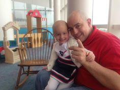Cutest little Texan cheerleader there ever was. Raelyn Cutbirth, two year old cancer patient and her daddy at Texas Children's Hospital.